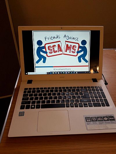 picture of laptop screen with friends against scams logo