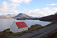 Red roofed crofthouse