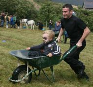 Wheelbarrow race.