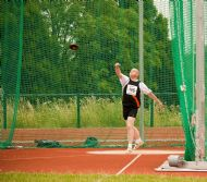 Davie Ogilvie throwing a discus in London