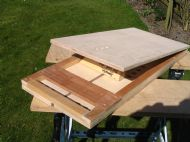 Bellows boards, reservoir frame and reservoir top.