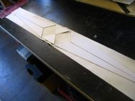 Card stiffeners glued onto bellows leather.