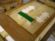 Inside flap valves and stop block for reservoir top board..