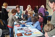 Jewellery making - voluteers lending a hand