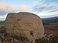 Charlie climbing the Rhumb at the Drake Stone, Northumberland
