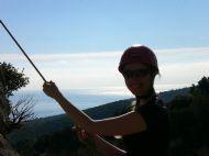 Natalie enjoying the sun whilst lowering off La Budinetto Crag, Cala Gonone - Sardinia