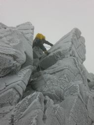 Chris heading leftwards at the top of Goat Track Gully, Coire an t-Sneachda