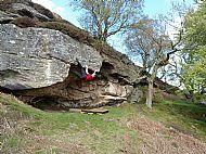 Climbing 'Cave Dweller' at Shaftoe