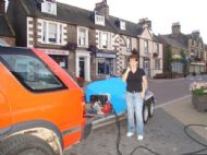 Jaki Gardner helping me water High St flowers