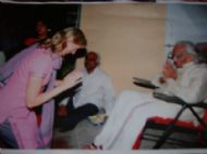 donna greeting guruji at the guru purnima celebration, riymi july 2005