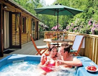 relax in the log cabins with hot tubs